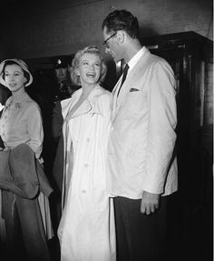 Marilyn Monroe with her husband, playwright Arthur Miller, at Heathrow Airport (1956).