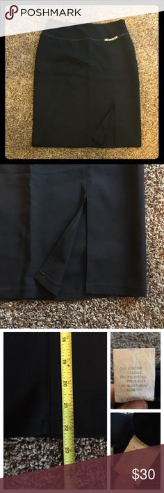 "Black skirt, with slit, size 10 Fun black skirt with a slit on the front side of left leg, flirty but classy, cute ""belt like"" design on the front of skirt, zipper in the back, length appr. 22 inches, 72% viscose, 25% polyester, 3% elastan, waist measures 14"" laying flat (28"" total), German size 38, US size M, preloved, only 2 times worn and in great condition Skirts"