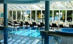 Indoor pool with fantastic view at the lake caldaro