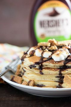 S'mores Pancakes - toasty marshmallows, chocolate syrup, and graham crackers for breakfast! So good! #ad