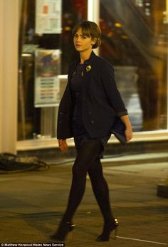 Strutting her stuff: Jenna sheds the coat to reveal stunning figure during filming Doctor Who series eight in  Cardiff Bay