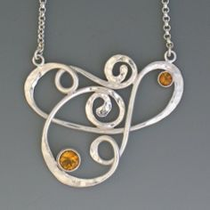 Loop in Loop Necklace in Sterling ( I did something similar in copper, now to set the peridot and finish it, inspiration is good :) )