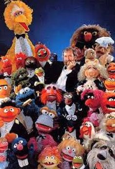 Jim Henson with Big Bird, Two-headed Monster, Rowlf the Dog, Dr. Teeth, Yorick, Sweetums, Statler and Waldorf, Swedish Chef, Oscar the Grouch, Kermit the Frog, Miss Piggy, Janice, Bert, Cookie Monster, Sgt. Floyd Pepper, Gonzo, Foo-Foo, Pink Frackle, Scooter, Animal, Ernie, Thug Monster, Winky Pinkerton, Camilla the Chicken, Uncle Travelling Matt, Mary Louise, Grover, Boo Monster, Molly Monster, Robin the Frog and Sprocket.