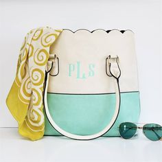 Grab your Krafty Chix EXCLUSIVE! You can't find this gorgeous two toned tote anywhere else!! We know you gals LOVE your scallop totes and wanted to design a special two toned tote with you in mind! Our best selling tote is now offered in an ivory and color combo of your choice! Personalize with your monogram. This is the perfect tote for spring and summer! Grab yours today, these won't last long!