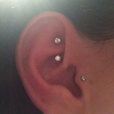 Rook with white gold and CZ curved barbell. #bodyelectrictattoo