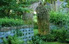 willow arbor and basket weave fence! Image via: http://pinterest.com/source/bunnyguinness.com