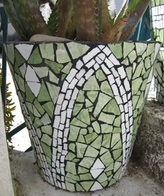 Wall tile on ceramic pot. From: http://multicoloredpieces.blogspot.com/p/mosaics.html