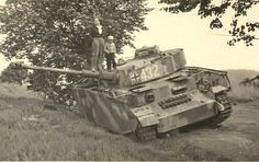 Civilians stand atop an abandoned German Panzer IV tank, Panzer Iv, German Soldiers Ww2, German Army, Soviet Army, Military Armor, Ww2 History, Tiger Tank, Ww2 Photos, War Dogs