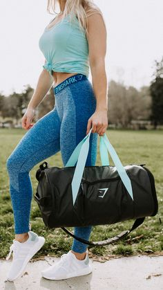 Athlete, Whitney Simmons styling the Women's Barrel Bag. There to keep you organised, prepared, and ready for whatever the day may bring.