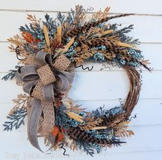 This wreath combines sophisticated elegance with country charm for versatile appeal. Premium latex berries in multiple shades of blues, fronds