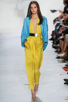 DVF Spring 2013 // Yellow jumpsuit with metal belt and jacket