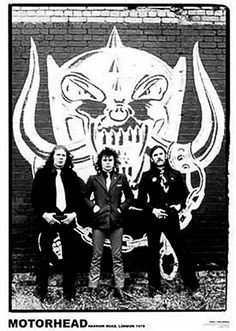 MOTORHEAD POSTER Lemmy at that Motorhead Poster! Bring the iconic English metal band to the walls of any room in the house. Poster features the iconic Motorhead Snaggletooth logo spray painted on a wall with the band in front. $7.00