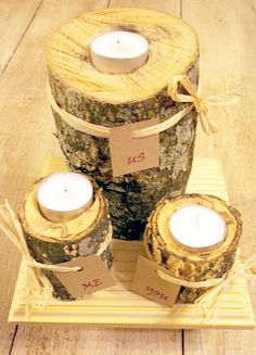 Rustic Wedding Unity Candle with raffia bows and tags. $35.00, via Etsy, or DIY.