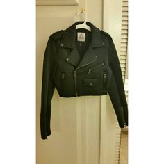 Brand new black UNIF neoprene moto jacket Features all the classic elements like a full front zipper, two sides, one breast side zipper pocket, button collar, zip sleeves and fitted slimming moto cut UNIF Jackets & Coats