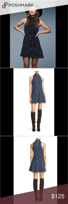 Free People Boho Chic Dress Free People Dress.  NWT.  Boho chic inspired blue black knitted short dress with dropped waist and flared skirt. Sleeveless, back zip closure, turtle neck. Very flattering fit, stretchy. Elegant and sexy dress – great for any season! Free People Dresses Mini