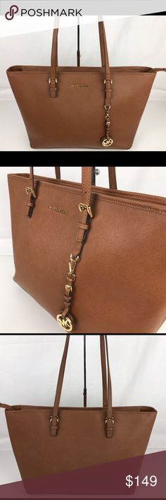 """Michael Kors Jet Set Saffiano Leather Top Zip Tote Condition: Gently used. Minor light wear on inside liner. Very good exterior.   Join the jet set with this leather tote from MICHAEL Michael Kors. Its roomy silhouette and utilitarian zip compartment hold all your travel essential. Double shoulder straps with 8.5"""" Drop. Zip Top. Interior zip pocket. 17""""L x 11.5"""" x 5""""W. Style 30T5GTVT2L. Our bag # RB202  Thank you for your interest!  PLEASE - NO TRADES / NO LOW BALL OFFERS Michael Kors Bags…"""
