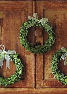 Wreath vignette ...I like idea of a small wreath on multiple cupboard doors