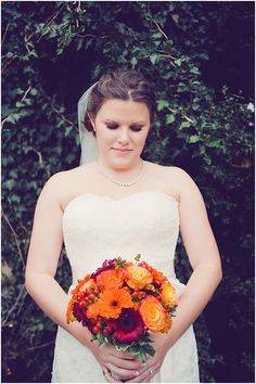 Fall bridal bouquet: roses and Gerbera daisies in shades of red and orange. Evergreen Country Club in Haymarket, Virginia. Image by Photography Du Jour