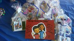 "Caleb and Sophia goody bags with butterfly pencils, notebooks for the meeting, stickers, caleb's lollipop, Caleb book mark and plastic bugs from the video ""Jehovah created all things""- we assembled as a family worship activity."