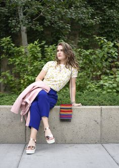 Image of Suzanne wearing bright summer colours, read more about it on The NEAT Blog, street style, blue pants, pink jacket, banana shirt