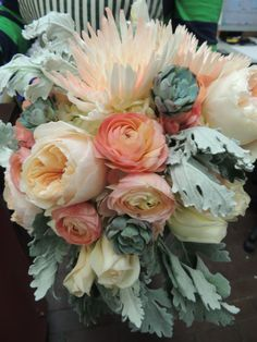 Beautiful bouquet of garden roses, dusty miller, rananculus, spider mums, and succulents
