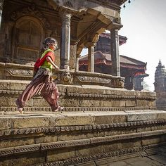 Photo by @CoryRichards // Two little feet off the ground on a happy day in Durbar Square, Bhaktapur before the earthquake. Much of daily life has returned to its 'normal' comings and goings...but the skylines will likely never be quite the same. Much of this particular area was completely leveled. Some of the temples are being restored, others reimagined. Regardless, there is still a magnetism and beauty that persists...but I think that is more tied to the people than the place or…
