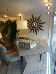 Sunburst #mirror and chic #table #window #display at our #NYC #Mecox location! #NewYork #interiordesign #MecoxGardens #furniture #shopping #home #decor #design #room #designidea #vintage #antiques #garden