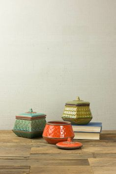 SET/3 CANISTER WITH TEXTURED DETAILS- ONE EACH COLOR  $45.00