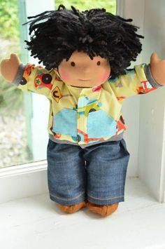 This is Damon, my first Bamboletta boy doll. He has dark tan skin, hair made with mohair and wool yarns in a black color with black nubby bits and brown eyes. He is wearing the pictured outfit, underpants and wool felt shoes.