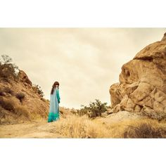 Desert Wanderer Maxi Kimono - Dawn by Spell - Maxi kimono with a beautiful print of feathers, thunderbirds and desert roses. Color: blue, green, turquoise . 100% rayon.