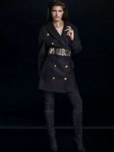 Balmain x H&M tailored coat, gold belt, and over the knee boots.