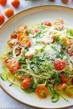 Parmesan Zucchini Noodles with Cherry Tomatoes - Made in one pan in only 10 minutes and loaded with Parmesan and sweet cherry tomatoes.