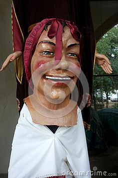 Photo about A great example of the Catalonian large head folk art masks called gigantes y cabezudos with a red bow. Image of mask, characture, catalunya - 80264255