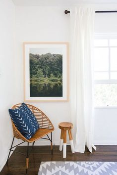 Loving this color-blocked wooden stool in a cozy reading corner.