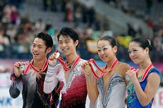 Men silver medalist Daisuke Takahashi of Japan, Men gold medalist Yuzuru Hanyu of Japan, Ladies gold medalist Mao Asada of Japan and Ladies silver medalist Akiko Suzuki of Japan pose for photographs at the medal ceremony after their competitions during day two of the ISU Grand Prix of Figure Skating NHK Trophy at Sekisui Heim Super Arena on November 24, 2012 in Rifu, Japan.