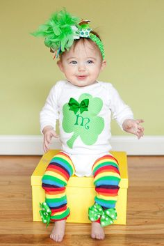Baby Girl St. Patrick's Day Outfit --  Lucky Little Girl  -- Over The Top bow, personalized onesie and rainbow leg warmers. $59.95, via Etsy.