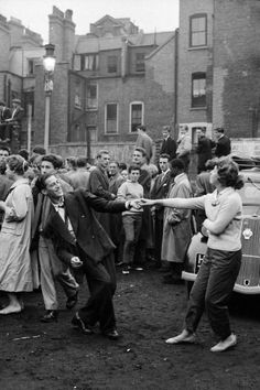 Teenagers dancing to a skiffle band in a carpark (bombsite) in Soho, 1956.
