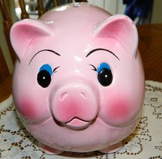 A Big Pink Piggy Bank~A Glossy Ceramic Piggy Bank~Big Blue Eyes & a Curly Tail~A Shiny Piggy Bank~Ready to Collect Lots of Cash and Coins~