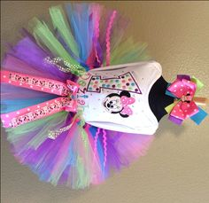 This is a Super Cute Pink Purple Lime Minnie Mouse 1st Birthday Tutu Set for Your little girl who will look so beautiful for her birthday photos in this adorable Outfit! She Will Be the Star of the Show!   This Girls Personalized Birthday Tutu Outfit comes with the Tutu, Embroidered and Personalized Shirt and a Matching Ribbon Bow on Headband with Clip.       High Quality Diamond Weave Shimmer Tulle is Used For All the Colors in Our Tutus!   All the Extra Frilly Ribbons around the Tutu and…