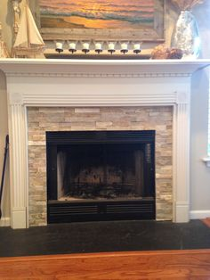 ledgestone--looks like the desert quartz. I like the hearth slab...maybe a little lighter/more charcoal than black??
