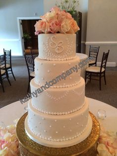 Simple ivory wedding cake with delicate white piping.