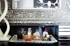 small shop for Adore Home photo by Sabra Lattos bedroom dresser vignette python tray perfumes