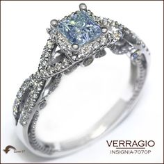 The unique, twisted design of the Insignia 7070P surrounds and highlights this Princess Cut Aquamarine center. Verragio Engagement Rings