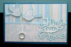 This card is made using the Storybook cartridge and Lyrical Letters cartridge. A pretty wedding ring is suspended by a string between to love birds.