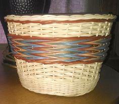 Cache pot basket using natural, carmel, reseda green, ? blue, and pumpkin reed