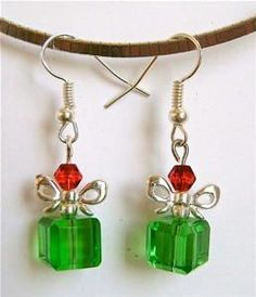 Whether you're making a gift for yourself or for a loved one this holiday season these Pleasant Present Crystal Earrings are the jewelry project you want. These DIY earrings in the shape of a present, making them perfect for stocking stuffers. Wire Jewelry, Jewelry Crafts, Beaded Jewelry, Jewellery Box, Jewelry Ideas, Gold Jewelry, Tanishq Jewellery, Jewellery Earrings, Jewellery Shops