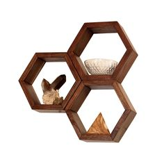 Hexagon shelves that look cool and help you take advantage of your wall space. Hexagonical!