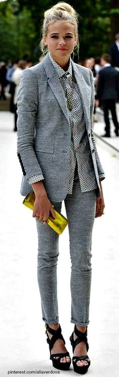 This womens suit is very remniscent of the 80s. This girl wears a suit that has matching jacket and trousers, she wears a tailored shirt underneath. The jacket has shoulder pads which was all the rage back in the 80s. She carries a cute clutch to bring a bit femininety to the overall look. The pants are very skinny, which was not common for women in the 80s (they typically wore a straight leg/slightly flared look). Allison Hauke. 4/11/17