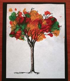 """Melted-crayon trees for fall. FREE printables include 7 bare-branch tree templates. Students sprinkle crayon shavings onto the branches, cover with a sheet of wax paper; adult presses a warm iron on top. The colors run together to make more shades of """"autumn leaves."""" Awesome results!"""