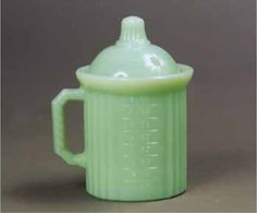 New Kitchen Glassware - A line of new kitchen glassware is available in the market. Most pieces are in opaque green glass commonly called Jadite but some are also available in vaseline and cobalt blue. RealorRepro.com @Ruby Lane Vintage